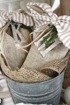 Burlap gift bags tied with glitter letters and fabric!