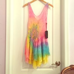 UNIF Tie Dye Bait Dress Super trippy rainbow tie dye UNIF bait dress. Brand new with tags, perfect condition. Not sure I'm going to sell yet because I love this dress! Perfect layering piece for year round wear. Size S but would also fit a M. UNIF Dresses Mini