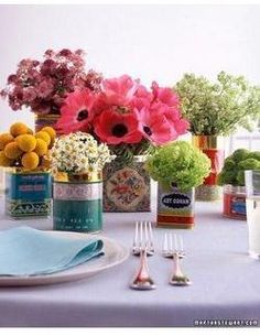 summer flowers in assorted tins....interesting and imaginative decore...I do this