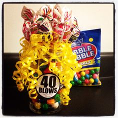40 Blows - Made with a Parmesan cheese shaker, bubble gum, Blow Pops and curling ribbon!