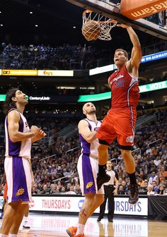 Blake Griffin #32 of the Los Angeles Clippers slam dunks the ball over Marcin Gortat #4 of the Phoenix Suns during the NBA game at US Airways Center on January 24, 2013 in Phoenix, Arizona.