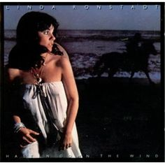 Linda Ronstadt.  Album:  Hasten Down the Wind.  One of my favorite albums from the 70's.  Ronstadt demonstrates her versatility covering several genres:  pop, rock, country, reggae, latin, and blues.