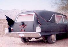Batwing Hearse! I would totally love driving around in this.