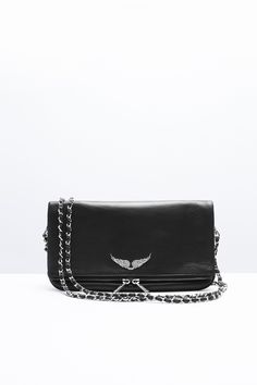 """Zadig & Voltaire zip clutch, two removable chains interlaced with leather, can be worn crossbody or on the shoulder, large rhinestone wings, 3 cm/1.25"""" D, 18 cm/7"""" H, 27 cm/10.75"""" L, 100% leather."""
