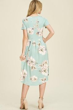 Cassie Dress (Mint) – ModestPop.com A gorgeous bold floral printed midi dress featuring front pleated skirt, flowy round hem line, and side pockets. This is the short sleeve version of our Haley Dress.