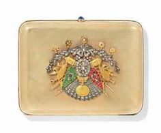 AN OTTOMAN GEM-SET GOLD CIGARETTE CASE, PERIOD OF ABDULHAMID II, 1879-1909 AD Of rectangular form with rounded corners, the lid set with diamonds and coloured gemstones with an armorial above a rococo swag, at the top an oval cartouche bearing the tughra of Abdulhamid II, one side with sapphire set push clasp