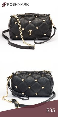 """Juicy Couture Quilted Hearts Mini Crossbody Bag NWT Juicy Couture black mini crossbody quilted hearts purse will define your accessories!  Compact size Gold-tone hardware Pink Crown signature logo print lining 4.75""""H x 5.25""""W x 2.5""""D Approx. drop down length: 25'' Adjustable crossbody strap zipper closure Interior: zip pocket Faux leather  *Bundle Discounts * No Trades * Smoke free Juicy Couture Bags Crossbody Bags"""