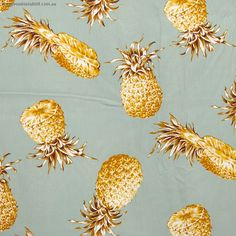 """Pineapple Toss Vintage Blue by Sevenberry - Pricing is per meter Large orange pineapples tossed over a vintage blue background. Main Colour/s: Blue Basecloth: 100% Cotton Bolt Width: 110cm (43"""") Weight: Light - Quilting and Apparel Weight Vertical Repeat: 30cm (11-3/4"""") Repeat Type: Basic Tile  While we make every effort to represent colour accurately, every monitor is different and we cannot guarantee the colours you see will exactly match the colours of actual fabric."""