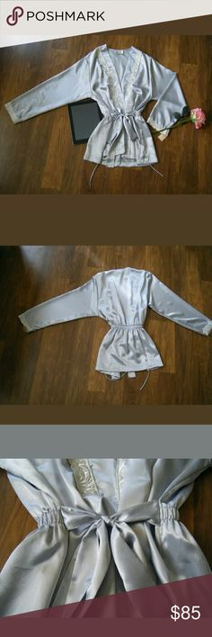 VTG Miss Dior Silver Blue Embroidered Trim Robe VTG Miss Dior Silver Blue Embroidered Trim Robe Size medium  Material polyester  New with tags    Color silver blue Item is stored in a pet & smoke free environment   *Miss Dior was an affordable line made by parent company Christian Dior Miss Dior Intimates & Sleepwear Robes