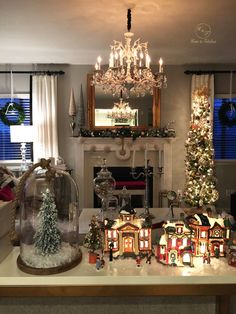 Christmas has made its way into the Home & Fabulous house! This mini town from HomeGoods was a great find. Love how festive and cozy it makes my living room look!  (Sponsored pin)