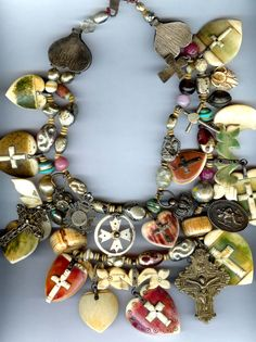 Necklace created using antique ivory beads and Goan hearts with crosses and other Indian amulets | Many of the components date to the 19th century