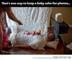 One way to keep a baby happy during a photo shoot. That's one good dad…