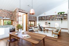 The living and dining space at Lawry St House by Ha | Australian Design Review | Photo by Kristoffer Paulsen  #Interior #Design #Timber #Architecture #brick