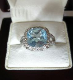 4.99 CT TW GENUINE DIAMONDS- SKY BLUE TOPAZ PLATINUM/0.925 STERLING SILVER RING