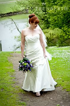Beautiful redhead, with purple bouquet.