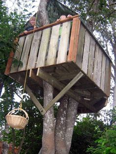 this is what my treehouse looked like. It had a basket, just like this one. I miss that place. that time.   DIY: how to build your own tree fort