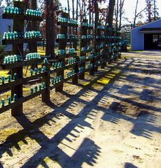artistic fence ideas | Driveway Fence Of Old Utility Poles With Glass Insulators | Love's ...