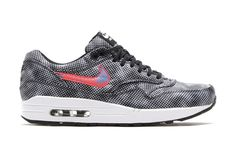 """Joining Nike Sportswear's """"Shine Through""""-inspired Black/White-Pure Platinum-Blue Lagoon colorway of the Free Hypervenom Mid is the latest edition of the Air Max 1 FB. Executed in a Black/Bright Crims..."""