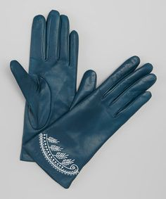 Accent an ensemble with chilly weather's standout staple! These gloves are crafted with genuine nappa leather to ensure every touch is sleek and soft, while a touch of detail adds a fashion-savvy element.