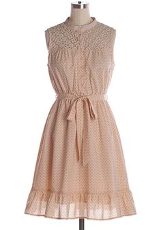 Welcome warm weather with this delightful light pink floral print cotton sundress with bottom ruffles, crochet accents, front buttons and waist tie. 100% cotton. Not stretchy. Bottom part lined. Self-tie at waist. Styling Tip: With a straw hat, locket necklace and nude flats you will look cute as can Indie, Retro, Party, Vintage, Plus Size, Convertible, Cocktail Dresses in Canada Lemonade Stand Dress in Pink -