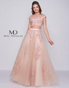 Delicate two piece prom dress. Fully embroidered crop top with cap sleeves. Embroidered applique throughout the taffeta skirt. Gown is fully embellished with dyed to match pearls and AB stones with a sateen waistband. Prom Girl Dresses, Homecoming Dresses, Nice Dresses, Two Piece Gown, Taffeta Skirt, Party Wear Lehenga, Prom Dress Shopping, Ball Gowns, Mac Duggal
