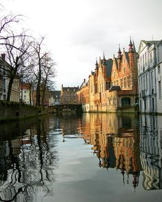 Bruges. Reflections on the canals of Bruges, Belgium (by Cath in Dorset)