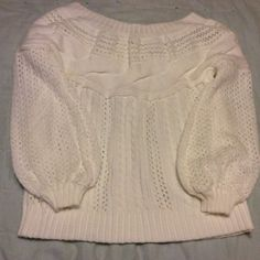 Off shoulder thick cotton sweater. This sweater is only going to fit a very small framed petite woman. Beautiful white cotton sweater could be worn from fall through spring, with a pair of cut off faded jean shorts, or jeans, it's very versatile. BUT REMEMBER LADIES, ONLY WILL FIT XS TO S. I also have this sweater in gray same sizes. Sweaters Crew & Scoop Necks