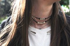 Die Happy choker necklace worn with a ripped white band tee shirt and leather jacket