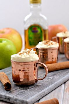 A Warm Apple Cider Shot Featuring Crown Royal - October 21 is National Apple Day. Celebrate with this delicious Warm apple cider shot in an adorable mini Moscow Mule mug!