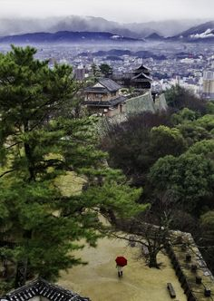 Matsuyama Rain - The view from the top of Matsuyama castle on a rainy day, Ehime, Japan.
