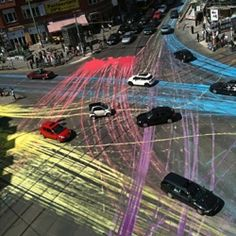 Guerilla Paint Action in Berlin. Last week a group of cyclists dumped 13 gallons of paint on the road at Berlin's busy Rosenthaler Platz, creating a series of colourful lines as cars drove through