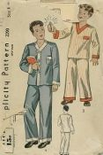 An original ca. 1930's Simplicity Pattern 2290.  Boy's Pajamas:  The slip-on jacket has a V-neckline with a pplied bands or fastens down the front with buttons or frogs.  The lower edges of the trousers are finished with applied bands.  Drawstring at the waistline.