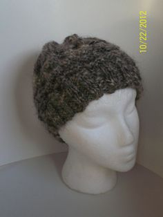 Hand Knitted and handspun  cap of sheep and angora goat. $30.00, via Etsy.