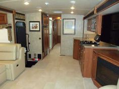 2015 New Winnebago Sightseer 35G Class A in Texas TX.Recreational Vehicle, rv, 2015 Winnebago Sightseer 35G, 2015 Winnebago Sightseer 35G, Mountain view/Amber Interior design, Exterior entertainment center w/TV & CD, Home theater sound system, Electric fireplace, Euro ultraleather lounge chair, Washer/dryer, King bed, Full body paint, Hi efficiency heat pump, Vinyl floor covering, Radio satellite, 4-door refrigerator, Ford F53 CHassis, 362 HP Triton V10 engine, Power brakes, 5000lb trailer…