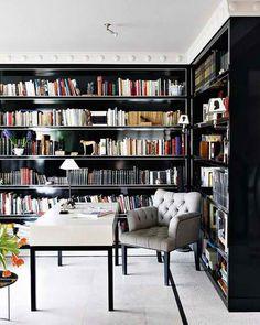 dark wrap-around bookshelves plus stark-white ceiling and floor = POP!
