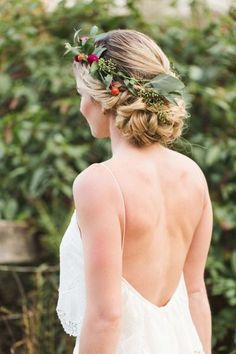 Braids woven into a bun & finished with a floral crown.  This look is beautiful.
