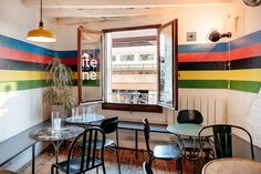 A view of the relaxed and inviting interiors upstairs, across the street from the main station, La Petite Reine Geneva. Geneva, Conference Room, Interiors, Street, Table, Furniture, Home Decor, Decoration Home, Room Decor