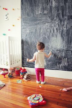 Loving this DIY chalkboard wall for your child's playroom