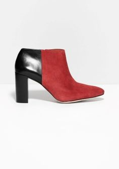 Luxe suede and calf leather build up these elegant ankle boots, featuring pointy almond toes and stacked block heels.