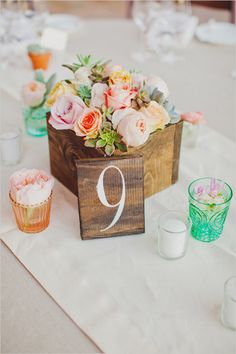 rose and succulent flower box centerpiece with wooden table number