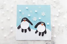 These handprint penguins are cute and easy to make for a fun Winter craft!