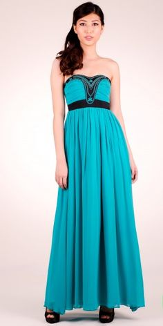 Cocktail maxi dress with embroidered details. A stunner.
