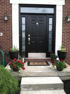 concrete-front-door-steps Black front doors are very versatile and suit any type of home Front Door Steps, Front Door Entryway, Exterior Front Doors, House Front Door, Glass Front Door, House Doors, House Entrance, Facade House, Entrance Doors