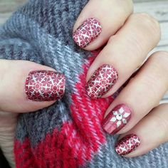Jamberry wraps in Ruby Love from our Holiday Gift Set Bundle (available until 12/31), Mai-Tai accent nail with a trimimg from Geo Diamond and a Design Dimensions in the center.  Shop this look on my website robinmccray.jamberry.com
