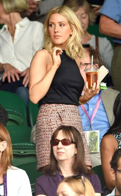 Ellie Goulding from 2015 Wimbledon: Star Sightings  Looking chic! The singer sports a bouclé skirt and black tank for the occasion.