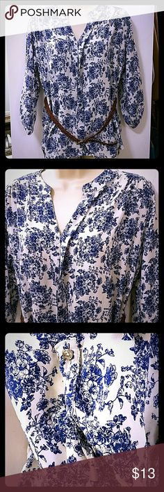 "Women's Blouse White with Blue Flowers Women's Blouse  3/4 sleeve length with buttons  White with blue floral print  Comes with stylish black belt  Size Large  Excellent used condition, it looks new  Measurements:   Pit to Pit- 20""  Length- 27"" (top of collar to hem)  Sleeve- 20"" (shoulder hem to cuff)   -----------------------------------------------------------------------------   Please be sure to check out my eBay store http://stores.ebay.com/CharMedia .. I am always getting new…"