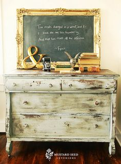 @Linda Bruinenberg Church Seed posted this lovely vignette on her blog. The chalkboard is displaying one of my favorite poems (Two roads diverged in a wood, and I took the one less traveled by. And that has made all the difference. -Robert Frost)