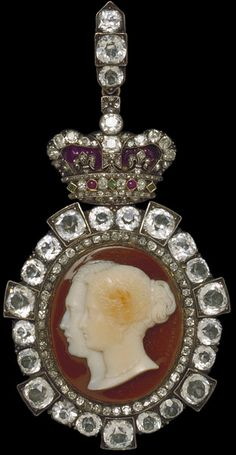 Double cameo portrait of Queen Victoria and the Prince Consort engraved in onyx. First Class Badge of the Royal Order of Victoria and Albert; oval onyx cameo with profile portrait of Victoria and Albert, in silver frame mounted with pastes, diamonds, emeralds and rubies.
