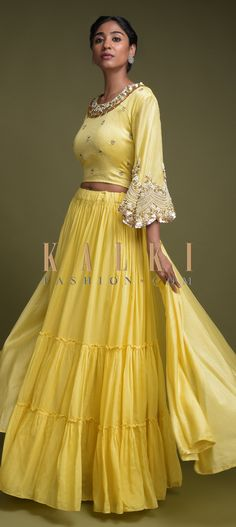 Buy Online from the link below. We ship worldwide (Free Shipping over US$100)  Click Anywhere to Tag Butter Yellow Skirt In Cotton With Tiered Silhouette And Matching High Low Crop Top Online - Kalki Fashion Butter yellow skirt in cotton with tiered silhouette.Teamed with a matching crop top with front high and back low pattern.