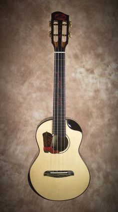 Chuck Moore builds hand crafted custom ukuleles on the Big Island of Hawaii using locally grown koa and native woods. Ukulele Instrument, Ukulele Chords Songs, All About That Bass, Cool Guitar, Musical Instruments, Gallery, Travel, Bass Guitars, Instruments
